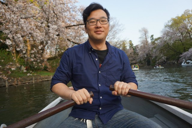 Japanese boyfriend paddling the boat